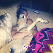 Kaley Cuoco cuddles up with her dog.