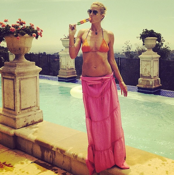 Heidi Klum beats the heat with a pool and a popsicle.