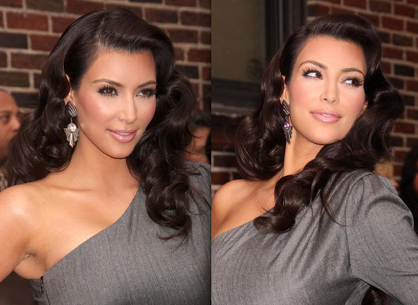 2011 prom dresses hairstyle. Kim Kardashian sported a side-parted old