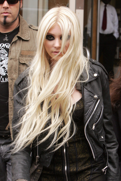 17-year-old Taylor Momsen teeters out of the Radio One Maida Vale Studios on some skyscraper gun stilettoes after performing live with her band, The Pretty Reckless. The