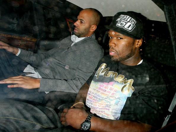 Signs of tattoo removal could be seen on 50 Cent's fore arms.