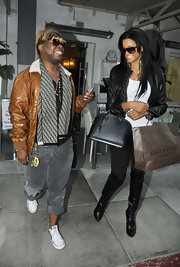 Claudia Jordan dined out in on trend black leather over-the-knee boots.