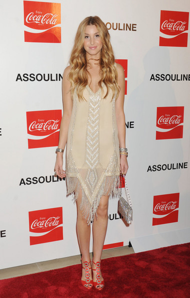 Actress Whitney Port wears a beaded flapper style dress at the launch of the 125th anniversary Coca Cola book in New York.