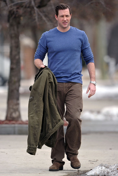 "Edward Burns holds onto his furry lined jacket while hanging about on the set of his new film ""Friends with Kids"", shooting on location in the Bronx."