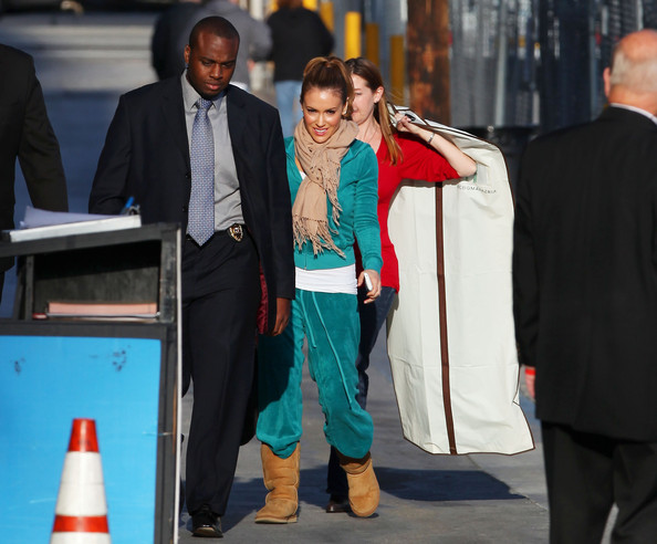 "Alyssa Milano, star of the new TV series ""Romantically Challenged,"" is escorted by bodyguards before her appearance on the ""Jimmy Kimmel Live!"" show. The actress, wearing a turquoise velour suit and a high ponytail, will appear in the new ABC sitcom playing a newly divorced single mother and lawyer who, as ABC puts it, ""hasn't been on a date since the Clinton administration."