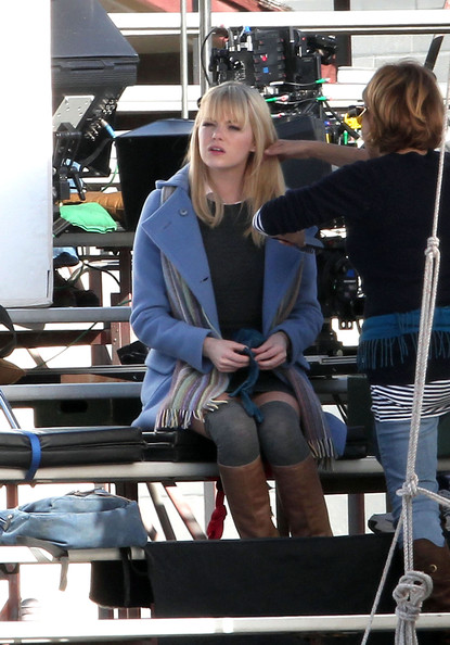 "Andrew Garfield - the new Peter Parker/Spiderman - and co-star Emma Stone film a kissing scene for the upcoming ""Spiderman 4"" film in Los Angeles. Garfield, best known for his role in the recent film ""The Social Network,"" is seen sitting on bleachers with co-star Stone. Both stars stayed bundled in thick coats and gloves. Garfield has reportedly been training for his ""Spider-Man"" body, making sure to get in shape for the franchise reboot."