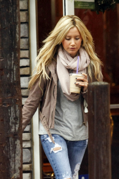Ashley Tisdale bundles up after grabbing an iced drink at Coffee Bean. Tisdale sported ripped jeans and combat boots, before getting into the passenger side of a Prius.