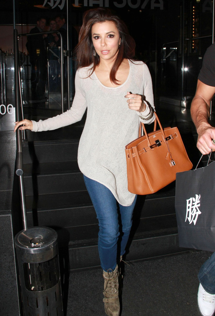 BFFs Eva Longoria and Mario Lopez take home doggie bags after dining together at Katsuya restaurant in Los Angeles.