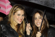 """Battle: Los Angeles"" actress Susie Abromeit is spotted leaving Chateau Marmont on a rainy night with a pink Victorias Secret umbrella."