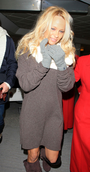 Baywatch beauty Pamela Anderson arrives at Heathrow Airport