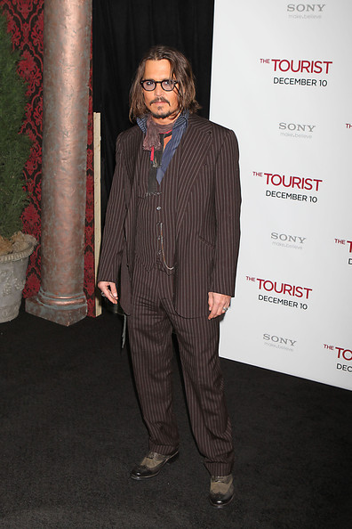 Johnny Depp dressed in a thirties style pin stripe suit on the red carpet on at the world premiere of The Tourist at the Ziegfield Theater in New York..