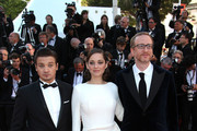 Director James Gray (glasses), Marion Cotillard and Jeremy Renner attend 'The Immigrant' red carpet premiere during The 66th Annual Cannes Film Festival at the Palais des Festivals.