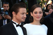 Marion Cotillard and Jeremy Renner attend 'The Immigrant' red carpet premiere during The 66th Annual Cannes Film Festival at the Palais des Festivals.