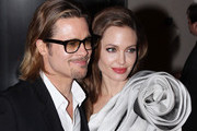 Power couple Angelina Jolie and Brad Pitt pose outside of the