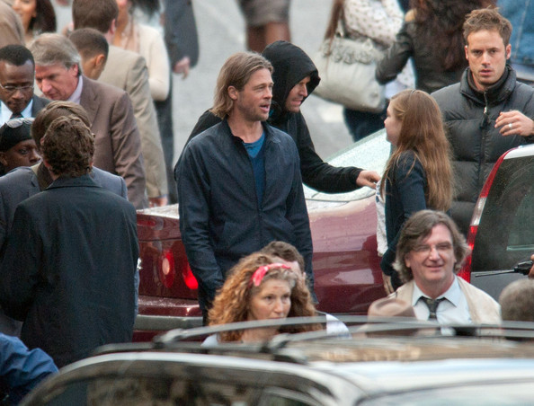 "Brad Pitt relaxes between takes on the set of new Zombie flic ""World War Z""  in Glasgow's George Square ."