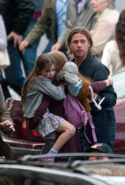 "Brad Pitt films a zombie scene with Mireille Enos in Glasgow's George Square on the set of ""World War Z"" ."