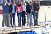 """Courteney Cox, Brian Van Holt, Busy Philipps, Ian Gomez, and the rest of the """"Cougar Town"""" cast look to be in shock as the boat they launched begins to scene during a scene."""