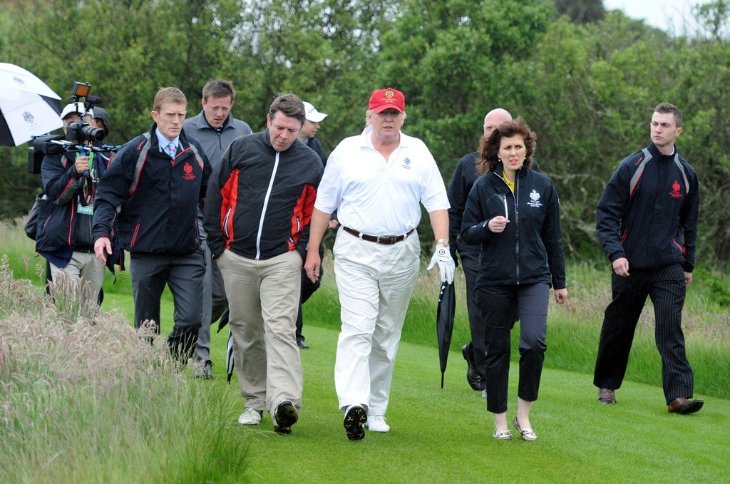 Business magnate Donald Trump takes to the course at the ...
