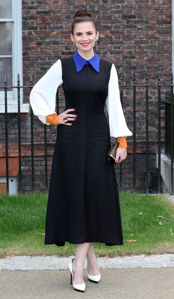 Actress Hayley Atwell seen posing for photographs as she arrives at the opening of the Fashion Rules exhibition at Kensington Palace in London