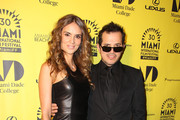 Actor John Leguizamo with actress Karen Martinez(wife of famous Colombian musician Juanes) at the premiere of 'The Trip 2' at the Miami Film Festival in Miami Beach.