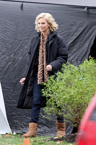 "Charlize Theron puffs away on a cigarette as she prepares to film a scene for the upcoming film ""Young Adult"" in NYC. The 35-year-old South African actress stayed warm in a thick black coat and ugg boots. Theron's character is Mavis Gary, a divorced writer who returns to her hometown to find that a former lover she wanted to reconnect with is married with a family."