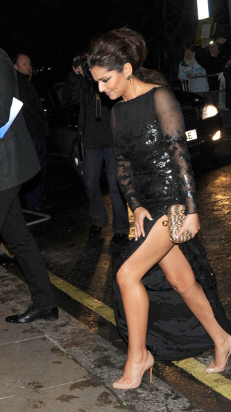 Cheryl Cole Cheryl Cole heads to the Brit Awards afterparty at the Savoy hotel wearing her black sequined Stella McCartney gown.