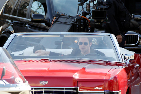 ".Chris Pine drives around in a red convertible car during a scene for his upcoming film ""Welcome to People"" in Downtown Los Angeles. The ""Star Trek"" actor was all smiles in between takes, taking off his brown blazer to stay cool in the unusually warm day."