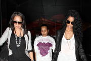 Ciara and Lala Vasquez return to their car after dining at Katsuya sushi restaurant. The singer was carrying a studded Givenchy handbag and wearing towering latice Christian Louboutin heels.