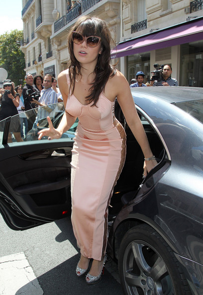 Daisy Lowe steps out in a fabulous pink Gaultier corset dress at the Jean-Paul Gaultier fashion show, held at his showroom in Rue Saint-Martin, Paris. After the show, the models walked along a red carpet in the street in his extravagant couture creations. The designer later held a party to celebrate his new men's fragrance.