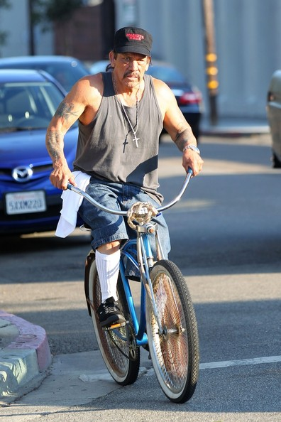 Danny Trejo Photos Dressed In A Tank Top And Beach Cruiser Los Angeles