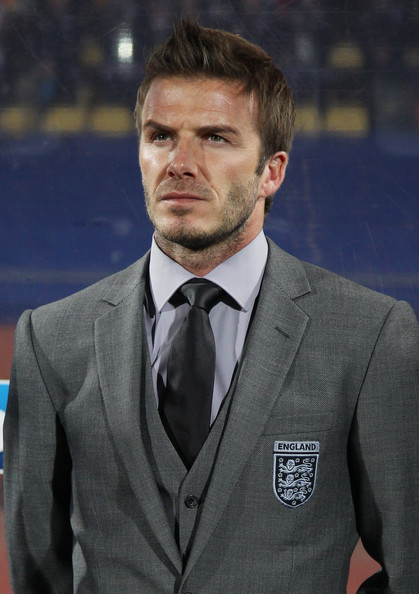 david beckham england soccer pictures. David Beckham on the bench of