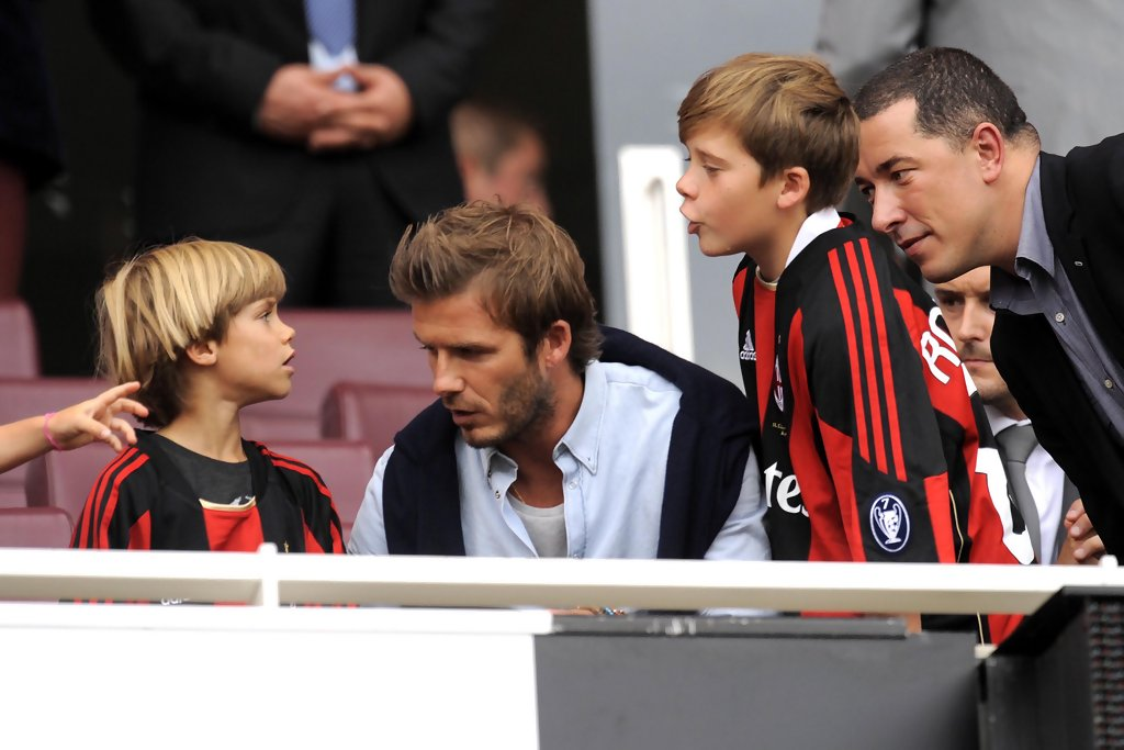 Romeo Beckham Photos Photos - David Beckham watches the ...
