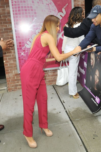 "Model/soap opera actress Denise Vasi signs autographs outside of the ""Wendy Williams Show"" in New York City."