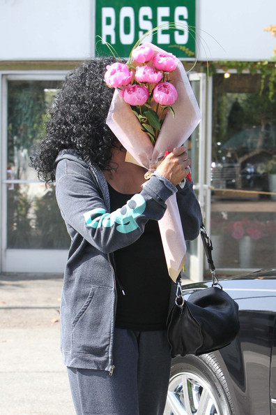 Diana Ross Diana Ross plays peek-a-boo with a beautiful bouquet of pink peonies as she leaves a florists in West Hollywood. Saturday marked the second anniversary of the death of her good friend Michael Jackson.