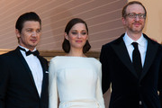 Director James Gray, Jeremy Renner and Marion Cotillard arrive for 'The Immigrant' screening during The 66th Annual Cannes Film Festival at the Palais des Festivals.
