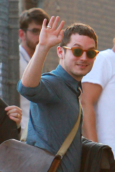 "Elijah Wood Actor Elijah Wood stops and smiles for photographs as he enters into the ""Jimmy Kimmel Live"" TV show in Los Angeles.  Wood is set to appear in a 30 minute film about the famous rap trio The Beastie Boys, directed by Beastie Boys front man MCA. Photograph: © Anthony."
