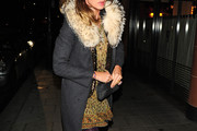 """Elizabeth Hurley, actress in """"Gossip Girl"""" and her fiance Shane Warne leave the 'C' restaurant in the Mayfair area of London. The couple was recently engaged after just ten months together after Warne proposed in a restaurant at the exclusive Old Course Hotel in St Andrews."""