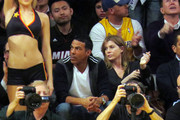 Ellen Pompeo and husband Chris Ivory take in a Lakers vs Miami Heat game at the Staples Center in Los Angeles.
