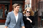 "Emma Stone walks arm in arm with a male friend as she goes out for a stroll sans boyfriend Andrew Garfield in NYC. ""The Amazing Spider-Man"" actress showed off her legs in a pair of short shorts looking a bit pale after the New York Winter."