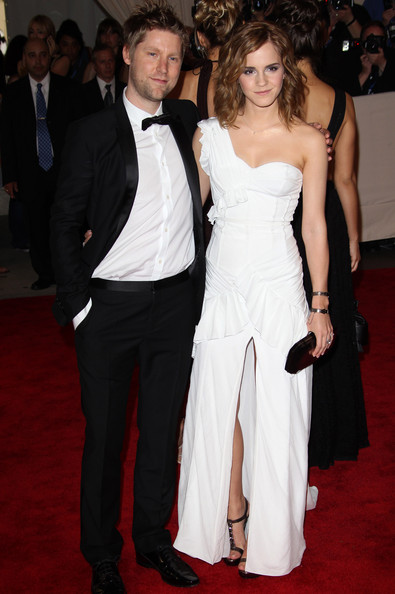 Emma Watson Monday May 3 2010..Emma Watson arrives with Burberry designer Christopher Bailey at The Costume Institute Gala celebrating the new exhibition 'American Woman - Fashioning a National Identity', held at the Metropolitan Museum of Art in Manhattan, New York.