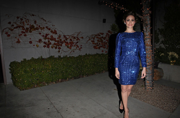 Emmy Rossum wears a sparkling blue dress with a mysterious bump in the midriff as she attends The Ripple Effect Benefiting the Water Project at Sunset Luxe Hotel