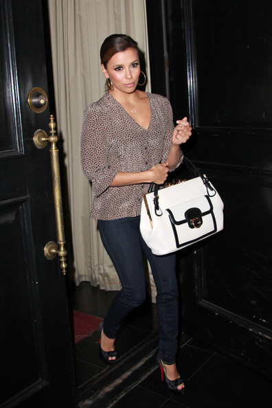 "Eva Longoria ""Desperate Housewives"" actress Eva Longoria is greeted by paparazzi as she exits her West Hollywood restaurant, Beso.."