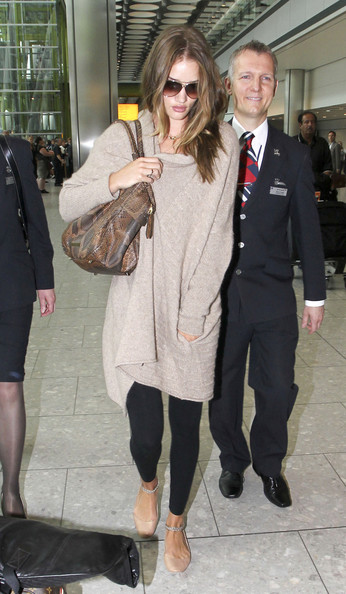 "FHM's Sexiest Woman Rosie Huntingdon-Whiteley arriving into Heathrow airport after a visit to the US for the MTV Movie Awards in New York.  The Victoria Secrets model will star in the next ""Transformers"" movie ""Dark Moon"" due for release later this month."