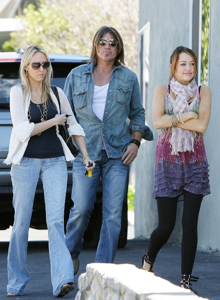 Miley Cyrus FILE PHOTO dated Sunday, March 16, 2008. Billy Ray Cyrus and wife Leticia Cyrus have reportedly filed for divorce after 17 years of marriage. **ORIGINAL CAPTION** Miley Cyrus spends the day out and about with her father Billy Ray and her mother Tish. First, the family headed to church. After the service, they visited a pet store and bought a rabbit, which they named Jack. Tish and Miley then dropped Billy Ray off at home before going to the mall for lunch and some shopping at Tuso. After shopping, mother and daughter bought coffees and Miley posed for photos with an employee of Fudruckers.