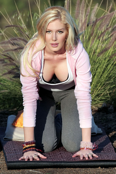 "Heidi Montag FILE PHOTO dated Saturday January 23 2010. **EXCLUSIVE** A radiant looking Heidi Montag appears to be in great spirits, as she is seen practicing yoga with her instructor outdoors. According to media reports, Heidi wants to go under the knife yet again although this time to remove the G size implants she had put in last year. Heidi told an American Magazine, ""I'm downgrading and going a little smaller, to a D or double D."" Nine months after having her last procedure, Heidi says that she is still in pain and that her body hasn't gotten used to her new form. Montag is allegedly searching for a doctor in South America after a car accident killed her previous doctor, Dr. Frank Ryan."