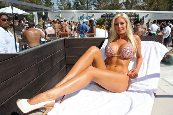 """**EXCLUSIVE** **FIRST BIKINI PICTURES** Heidi Montag shows off her new beach body in a self-designed bikini as she hosts the grand opening of the Liquid Pool Lounge at the Aria Resort and Casino in Las Vegas. It is the first time the """"The Hills"""" star and singer has been photographed in a bikini since undergoing 10 cosmetic procedures in one day late last year. The 23-year-old star underwent a mini brow lift, Botox in her brow and frownline area; a nose job revision; fat injections in cheeks, nasolabial folds and lips; chin reduction; neck liposuction; had her ears pinned back; a breast augmentation revision; liposuction on her waist, hips and inner and outer thighs; and a buttock augmentation."""