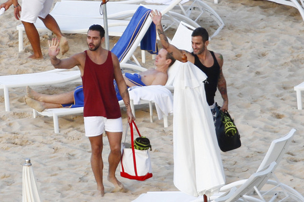 Famed designer Marc Jacobs leaves the beach in St. Barts with his ex-fiance Lorenzo Martone. The couple was seen hanging out with celebrity stylist Rachel Zoe.