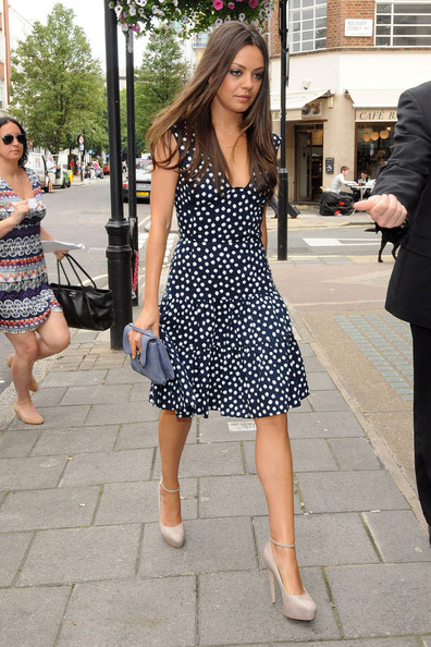 """Friends With Benefits"" stars Justin Timberlake and Mila Kunis arrive at BBC Radio One in London to speak with DJ Edith Bowman about their new movie. Mila was wearing cute spotty sun dress and killer nude heels - while Justin kept it casual with a flat cap and denims."