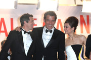 Guillaume Canet, Clive Owen and Marion Cotillard leave the Premiere of 'Blood Ties' during the 66th Annual Cannes Film Festival at the Palais des Festivals in Cannes.