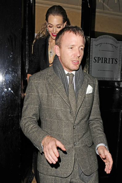 Guy Ritchie leaving his pub The Punchbowl in London, with girlfriend Jacqui Ainsley. Guy hosted an after hours party for friends and colleagues following the premiere of his second Sherlock Holmes film, staring Robert Downey, Jnr.